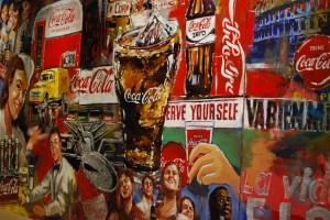 A collection of Coca Cola advertisements from around the world