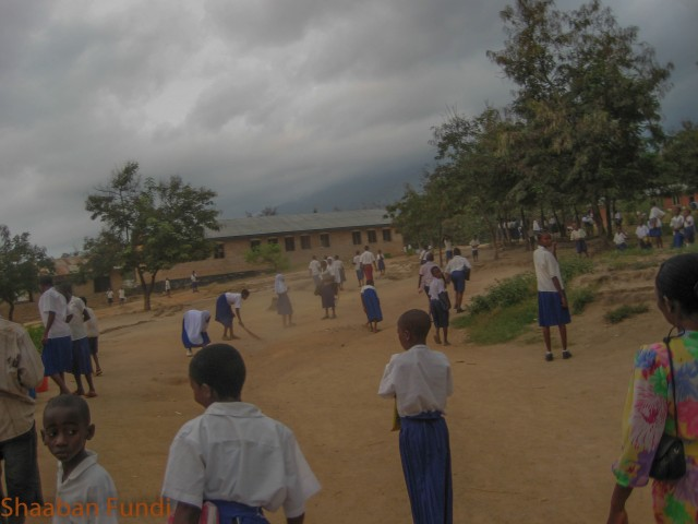 Pupils sweeping the ground in the morning